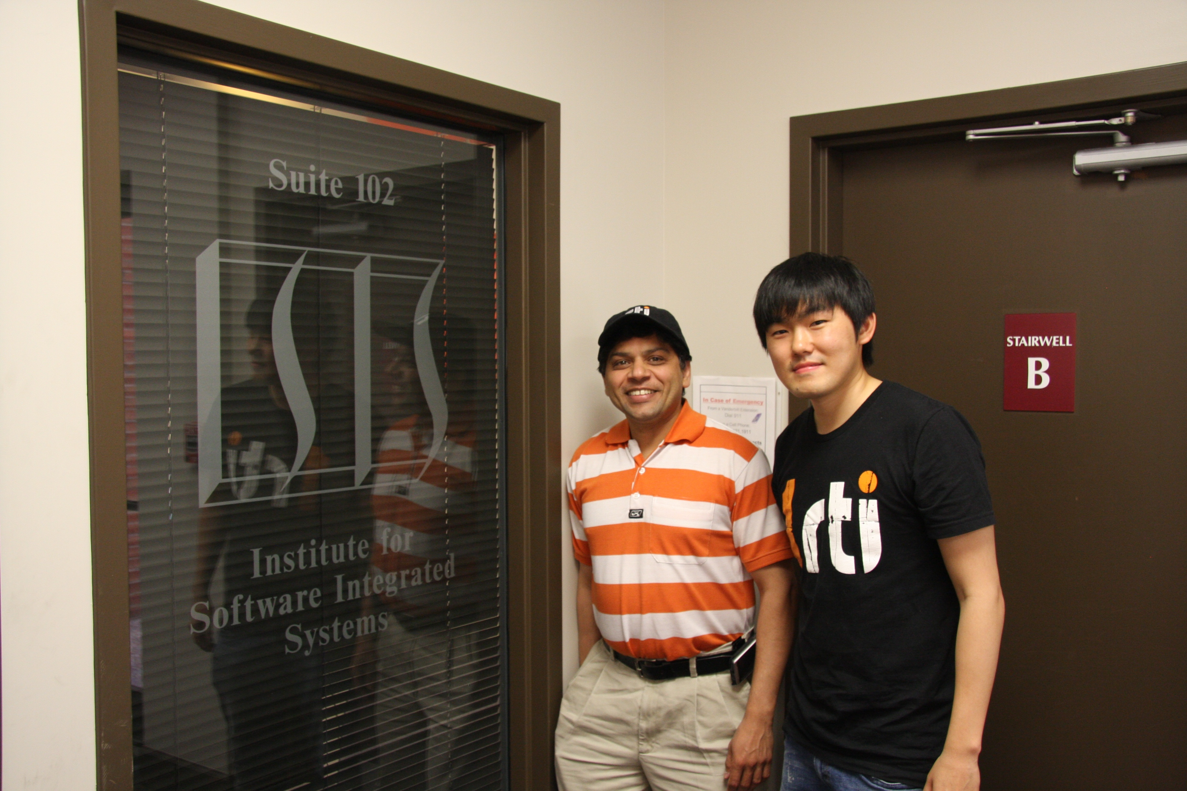 """Andy (team manager) and Kyoungho (project leader) """"sport"""" RTI gear"""