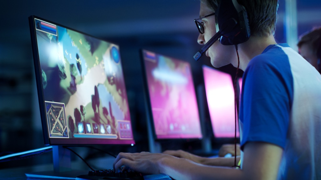 team-of-professional-esport-gamers-playing-in-competitive-mmorpg-picture-id841135958